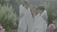Mom gives eskimo kisses to daughters in slow motion Stock Footage