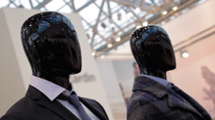 Black glossy mannequins exhibit a new collection of men's clothing in a shop Stock Footage