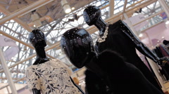 Black glossy mannequins exhibit a new collection of women's clothing in a shop Stock Footage