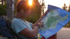 Young Handsome Traveler with Map on Road at Sunset Stock Footage