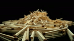 The camera goes to a big pile of matches on a black background Stock Footage