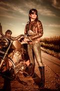 Biker girl and motorcycle Stock Photos