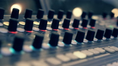Professional video mixing console where many knobs and many reflections. Closeup Stock Footage