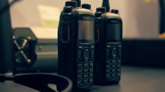 Two radios are on the table. Dolly shot. Shallow depth of field Stock Footage