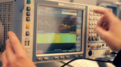 Scientist working with an electronic measuring device and see the results Stock Footage