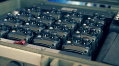 Rows of two-way radios are in the special charging device Stock Footage