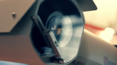 White security camera with windscreen wiper is checking the surrounding area  Stock Footage