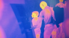 Infrared camera shoots passing people and transmits the image to a monitor Stock Footage