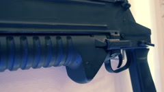 Manual grenade gun on the white wall Stock Footage