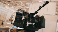 Heavy machine guns on the remote-controlled platform with infrared imager Stock Footage