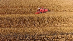 Aerial Footage Of Combine Harvesting Yellow Corn Field Stock Footage