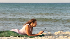 Beautiful girl with a tablet computer Stock Footage