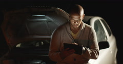 4k, African American man on his digital tablet while waiting for assistance Stock Footage