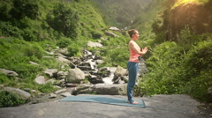 Woman doing yoga Sun Salutation Surya Namaskar Stock Footage
