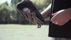 Baseball Player Tossing Ball into Glove Stock Footage
