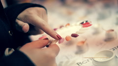 Girl have a choice of artificial nails, compares the different options Stock Footage