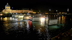 Pont des Arts, Institut de France and a cruiseship in the Seine at night. Stock Footage