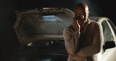 4k, An African American man calling roadside assistance for help Stock Footage