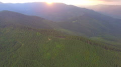 Beautiful sunset over the mountains. Aerial view Stock Footage
