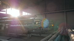 Steel Pipes bunch on the rack in warehouse. Modern stock on sunset, flares Stock Footage