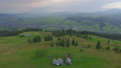 Sweet home at the peak of the mountain. aerial view Stock Footage