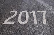 2017 text on asphalt road, new year concept Stock Photos