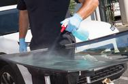 Glazier removing windshield or windscreen on a car Stock Photos