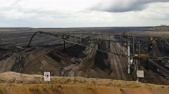 Giant brown coal open cast mine machinery in Germany Stock Footage