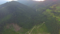 Mountain peaks covered with forest. aerial footage Stock Footage