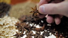 Hand of the cook take anise star-shaped during cooking and looking it. Macro Stock Footage