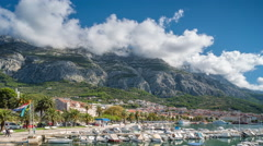 Daytime, time lapse of Makarska harbour and old town. Stock Footage