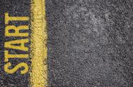 Word Start written on an asphalt road background Stock Photos