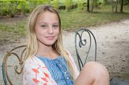 Pretty little girl smiling in a park close-up Stock Photos