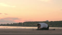 Flexible ya on the beachoung adult doing yog Stock Footage