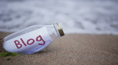 Blog written on a message washed ashore Stock Footage