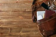 Leather bag with gadgets and notebooks Stock Photos