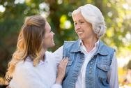 Mother and daughter hugging in the park Stock Photos
