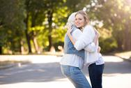 Young beautiful woman hugging her mother Stock Photos