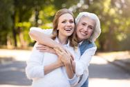 Two delighted happy women having a walk Stock Photos