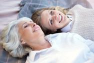 Smiling happy women laying on the plaid Stock Photos