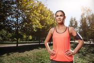 Smiling girl preparing for outdoors morning exercises Stock Photos