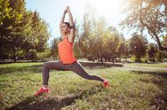 Athletic girl doing morning exercises Stock Photos
