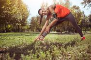Young girl doing stretching in the park Stock Photos