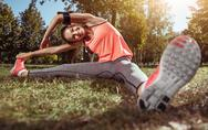 Smiling girl doing her sport exercises in the morning Stock Photos