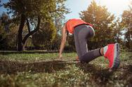Active girl having her morning exercises outdoors Stock Photos