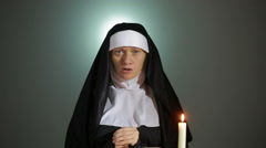 Halloween. nun prays. shadows in the form of devil. exorcism Stock Footage