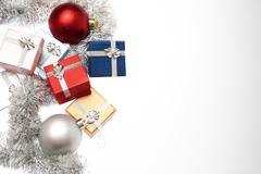Small boxes for christmas gift, christmas balls and christmas tinsel on white Stock Photos