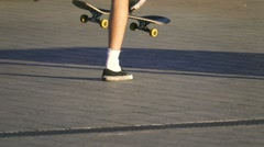 Young skateboarder kick turns his skateboard in the air, slow motion Stock Footage