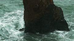 Ocean wave hitting rocks Foams spraying and splashing slowmotion Stock Footage