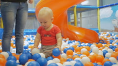 A boy plays in the leisure center of a large shopping center. Many interesting Stock Footage